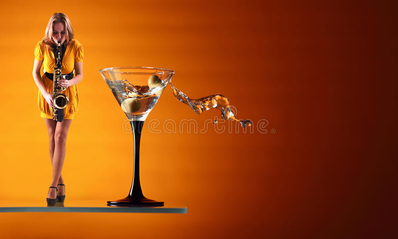 Martini blues. Martini and woman in yellow dress with saxophone stock photos