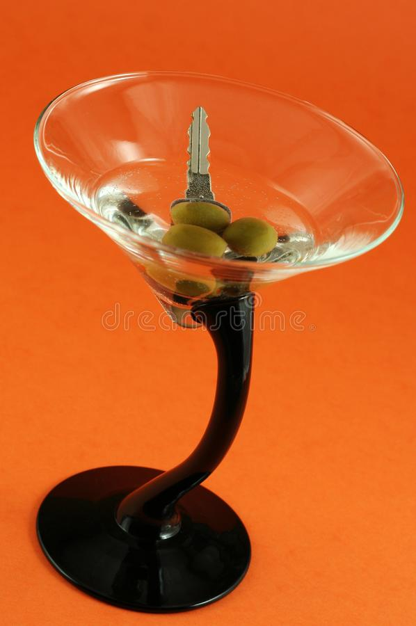 Martini with car keys inside royalty free stock photos