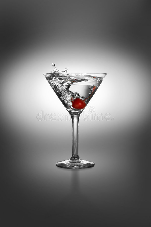 Martini with cherry splash stock photo
