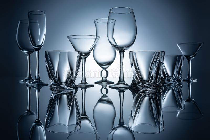 martini, cognac, champagne and wine empty glasses with reflections royalty free stock image