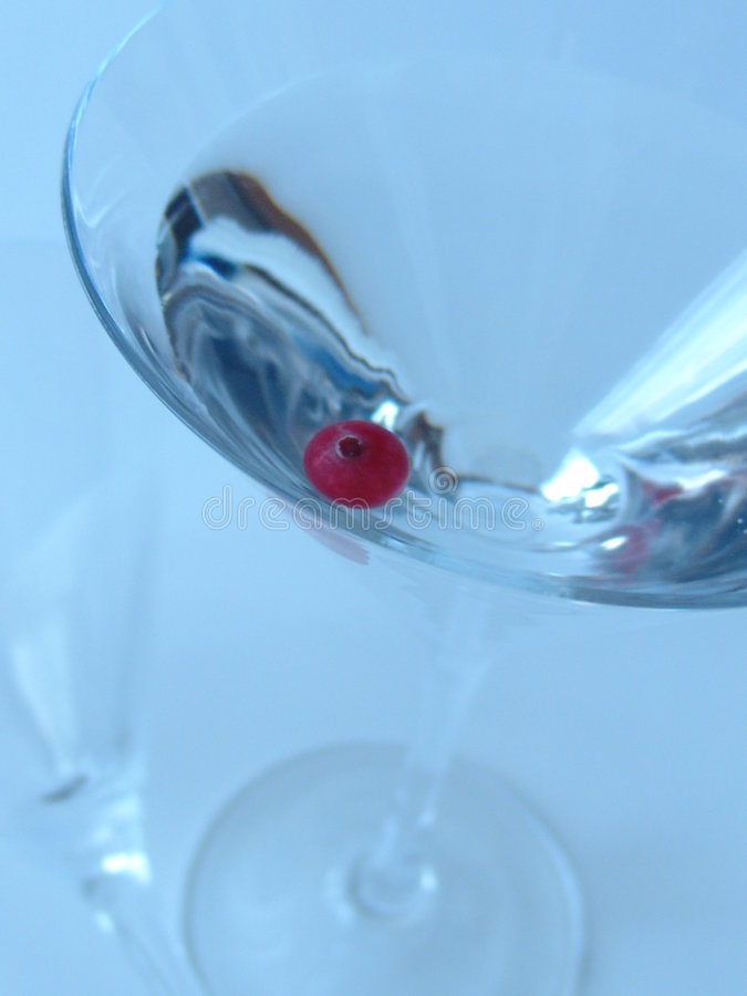 Martini glass. With red berry royalty free stock photography