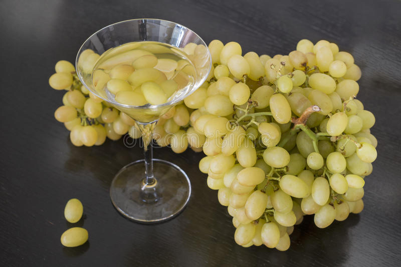 Martini glass and grapes. stock photos