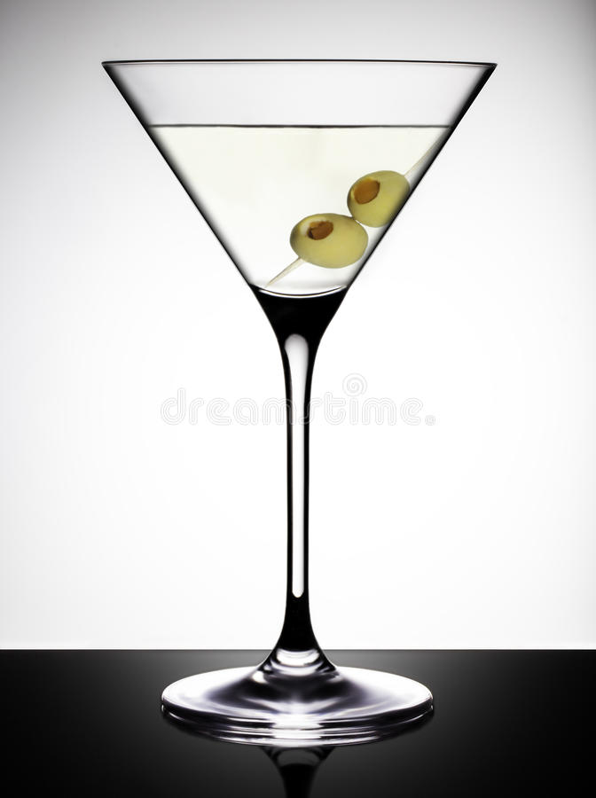 Martini Glass with Olives stock photography