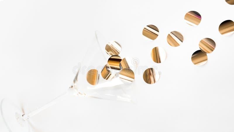 Martini glass with shiny confetti stock photos
