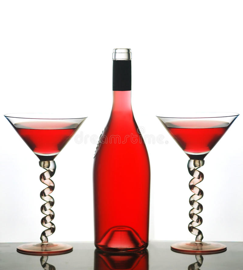 Martini glasses and red wine stock photography