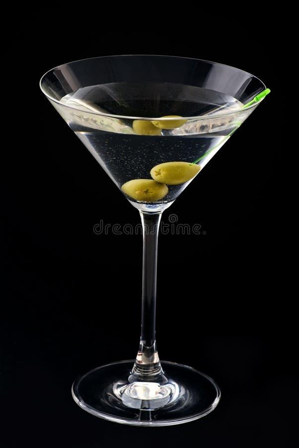 Martini med olivgrön royaltyfri foto