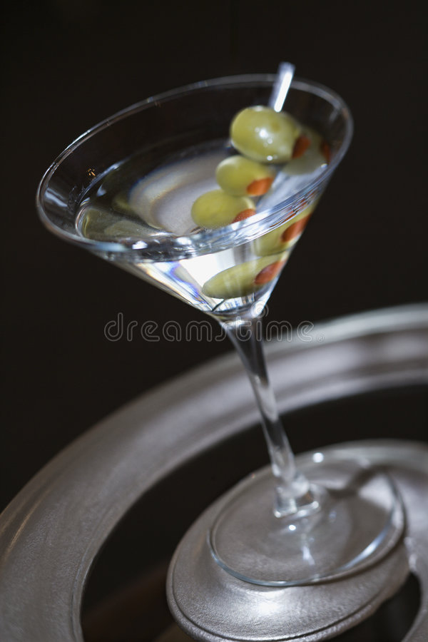 Martini with olives. royalty free stock image