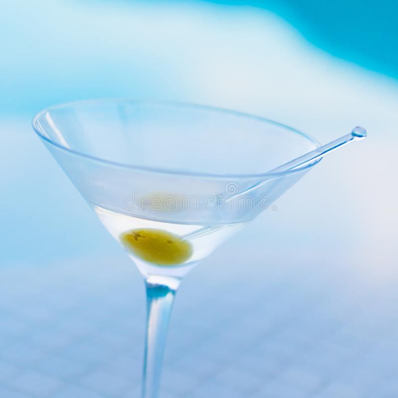 Martini on Pool Bar. With Olive royalty free stock photography
