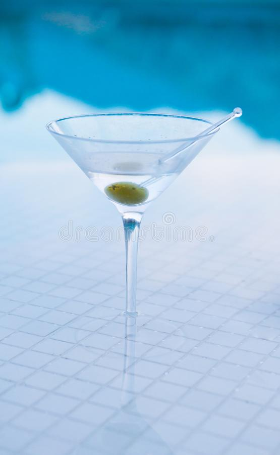 Martini on Pool Bar. With Olive stock images
