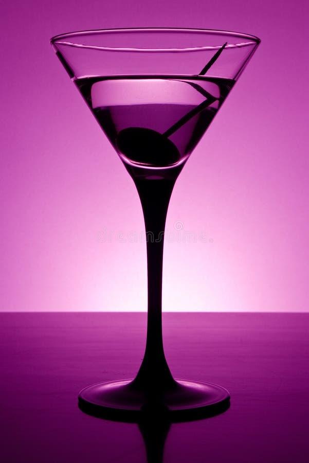 Martini in purple stock afbeeldingen