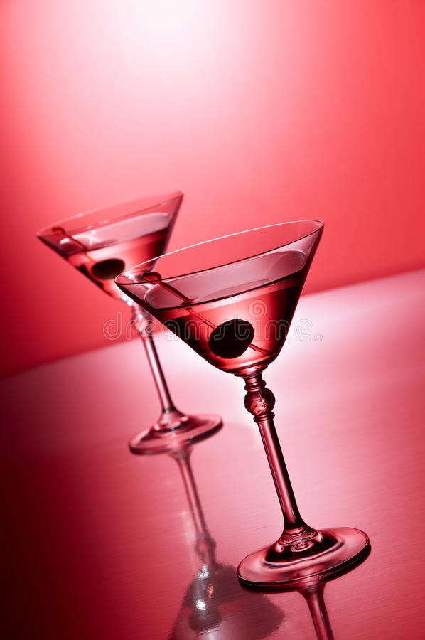 Martini on red. Two martini glasses angled on red stock photo