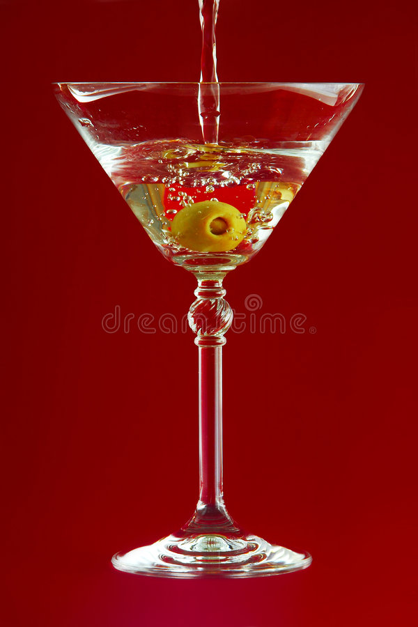 Martini on red background royalty free stock image