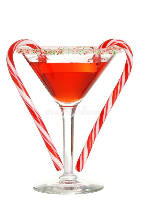 Martini rouge avec deux cannes de sucrerie photographie stock libre de droits