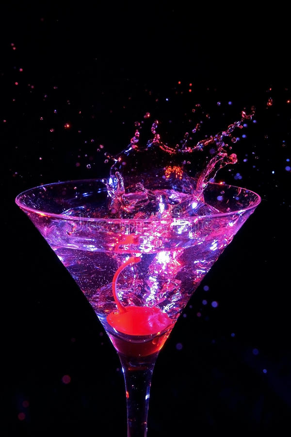 Martini splash. Red cherry splash in martini