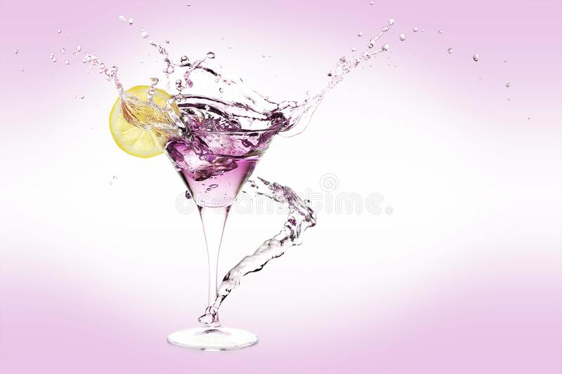 Martini splash. Splash of martini drink with lemon slice and ice stock photos