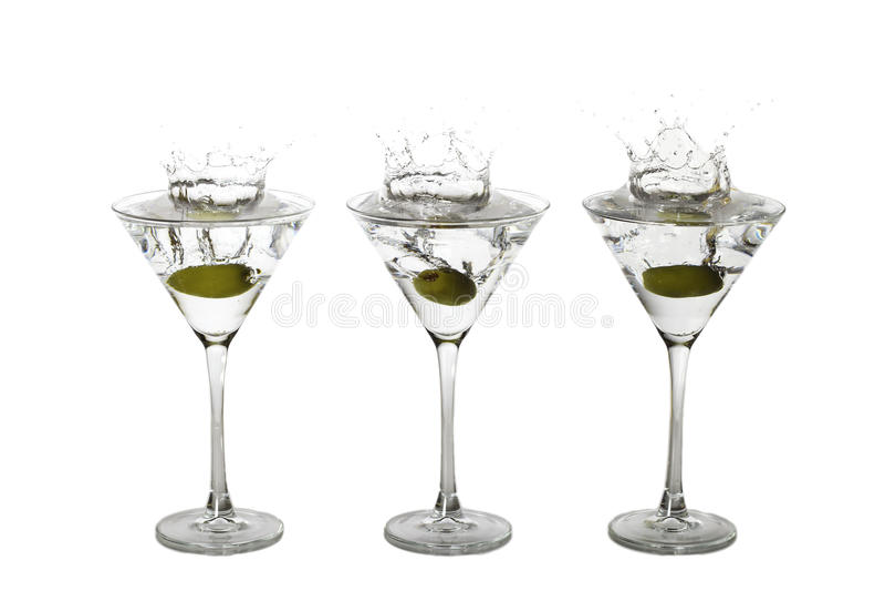 Martini Splash. Olives splashing into martini glasses royalty free stock photography