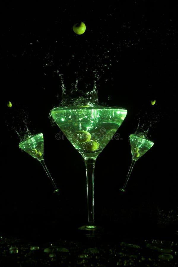 Martini Trio. Three is a crowd martini glass art stock photography