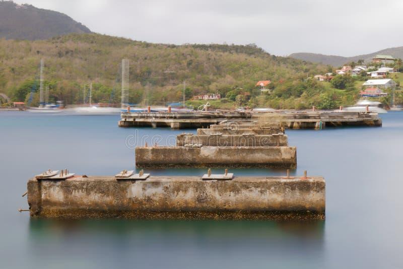 Martinique - gammal pir i Pointe du Anfall - lång exponering royaltyfria bilder
