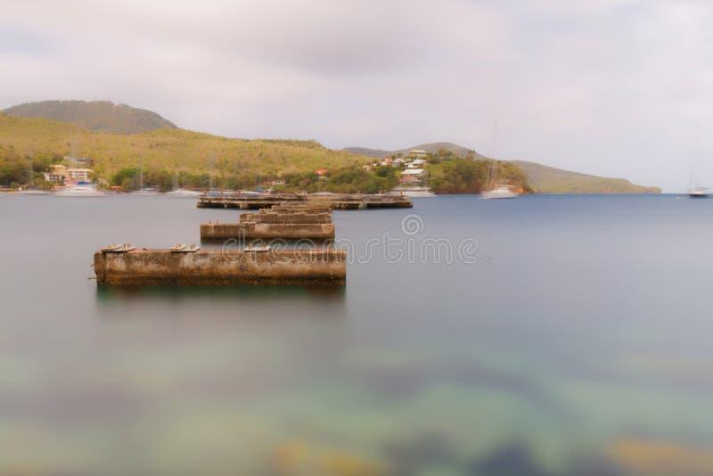 Martinique - gammal pir i Pointe du Anfall - lång exponering royaltyfria foton