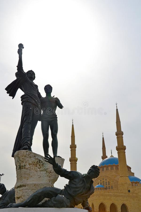 Martyrs` Square Monument and the Blue mosque in Beirut, Lebanon royalty free stock photography
