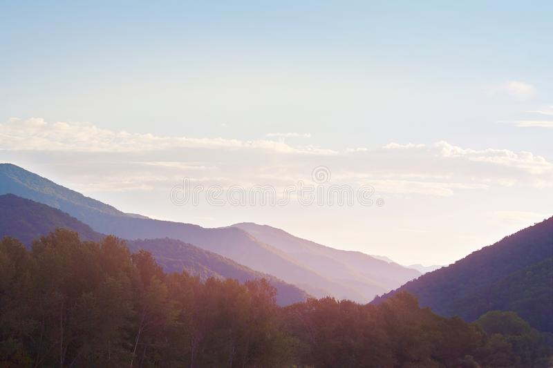 Marvellous dawning in mountains covered with forests. Marvellous dawning in the mountains covered with forests royalty free stock images