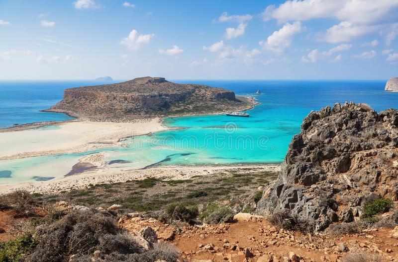 Marvelous landscape of a rocky hill, Balos beach with fantastic white sand and three seas: Ionian, Aegean and Libyan. Great summer stock photography