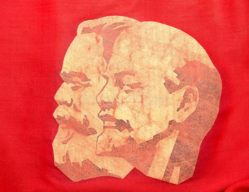 Marx och Lenin på rött baner fotografering för bildbyråer