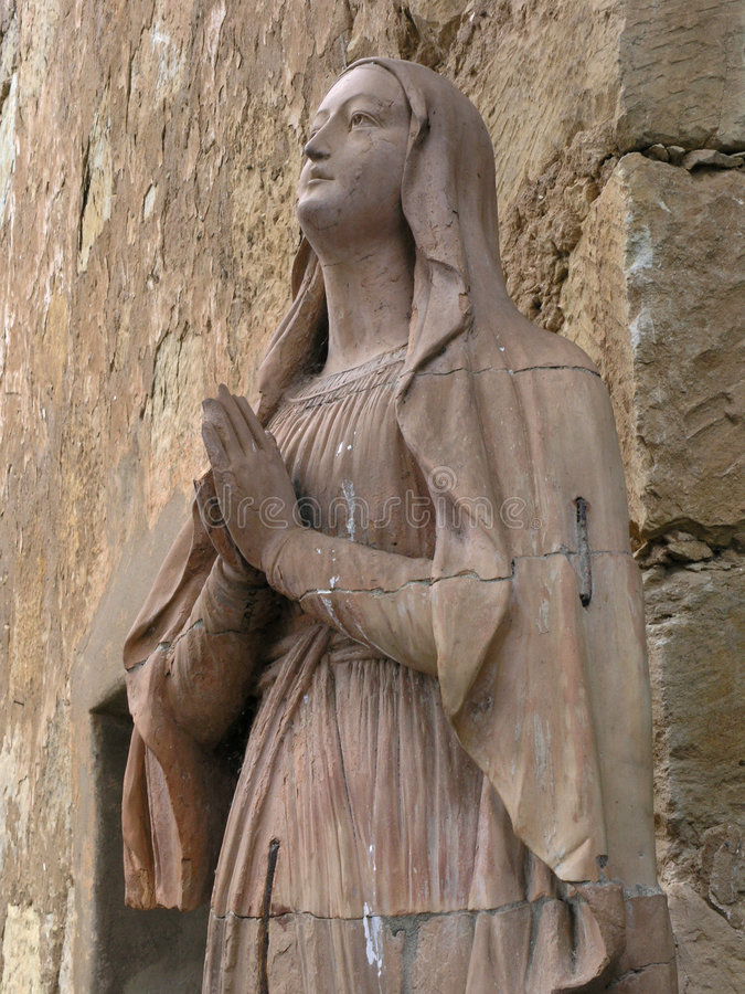 Mary, carved stone statue stock photo