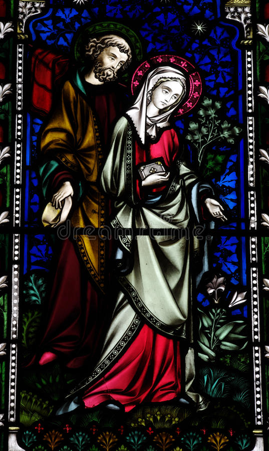 Mary and Joseph in stained glass. A photo of Mary and Joseph in stained glass stock photo