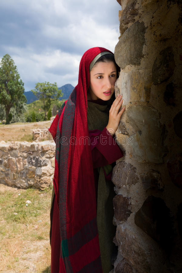 Mary Magdalene crying at the empty tomb. Mary Magdalene standing at the entrance of the empty tomb of Jesus on Easter morning stock image