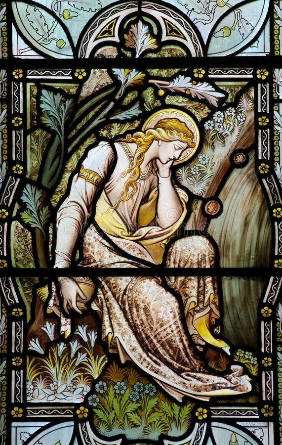 Mary Magdalene in stained glass. A photo of Mary Magdalene in stained glass stock photo