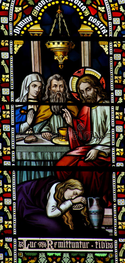 Free Mary Magdalene Washing The Feet Of Jesus In Stained Glass Stock Photos - 48003483