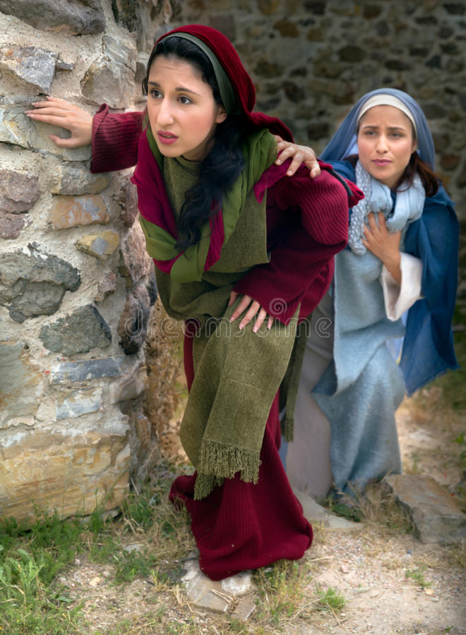 Mary and Mary Magdalene leaving the tomb. Mary and Mary Magdalene leaving the empty grave to tell the apostles that Christ has risen royalty free stock images