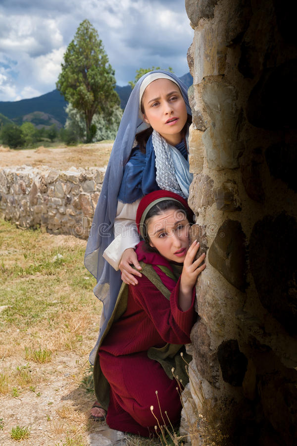 Mary and Mary Magdalene looking into the empty tomb. Mary and Mary Magdalene standing at the entrance of the empty tomb of Jesus on Easter morning royalty free stock photo