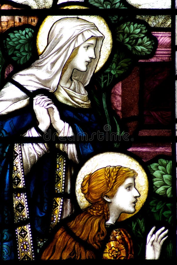 Mary and Mary Magdalene in a stained glass window. Stained glass window depicting May and Mary Magdalene royalty free stock photo