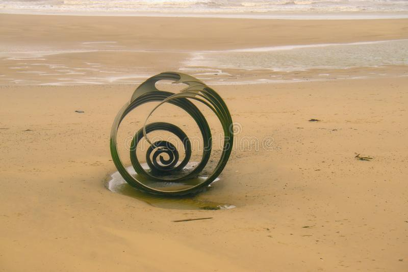 Mary`s shell on Cleveley`s beach. An end view of the sculpture Mary`s Shell by Stephen Broadbent it was designed with the children`s book The Sea swallow in royalty free stock image