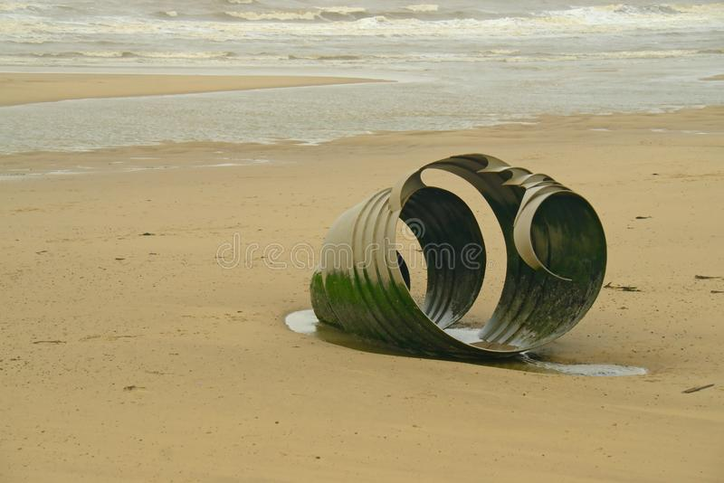 Mary`s shell on Cleveley`s beach. An end view of the sculpture Mary`s Shell by Stephen Broadbent it was designed with the children`s book The Sea swallow in stock images