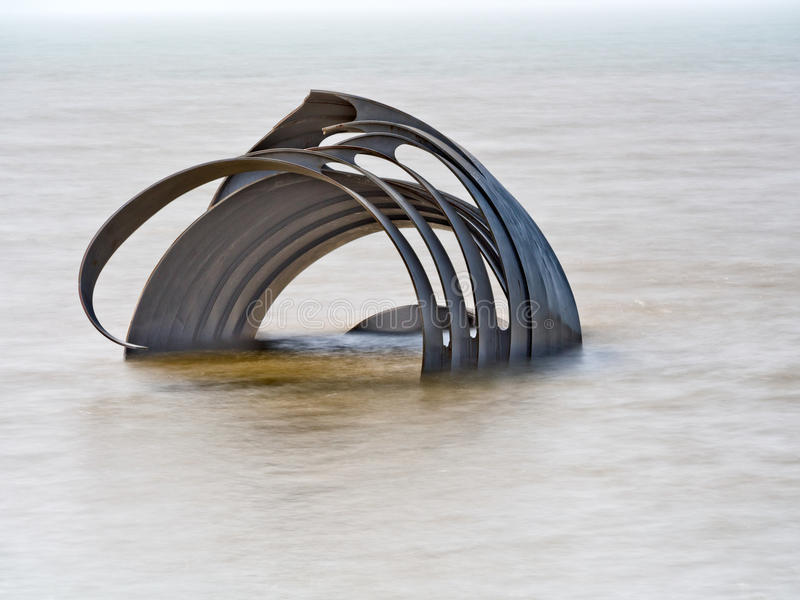Mary's Shell sculpture at high tide. Cleveleys beach, Lancashire, UK royalty free stock image