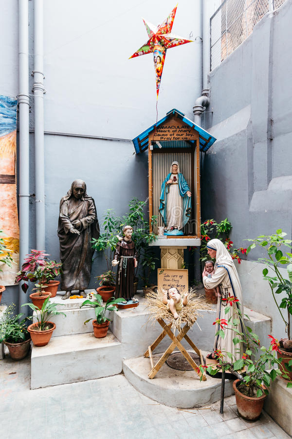 Mary statue with Saint Teresa of Calcutta statue in the Missionaries of Charity in Kolkata, India. Mary statue with Saint Teresa of Calcutta statue in the stock photo