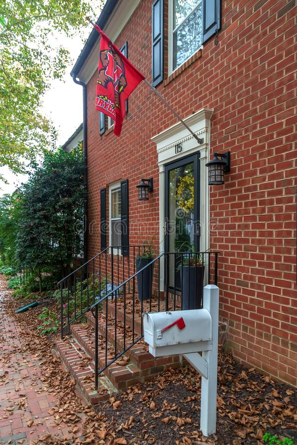 Maryland flag in front of typical american houses. Kentlands, Gaithersburg, Maryland, USA - August 31, 2018: Maryland flag in front of typical american houses stock photo