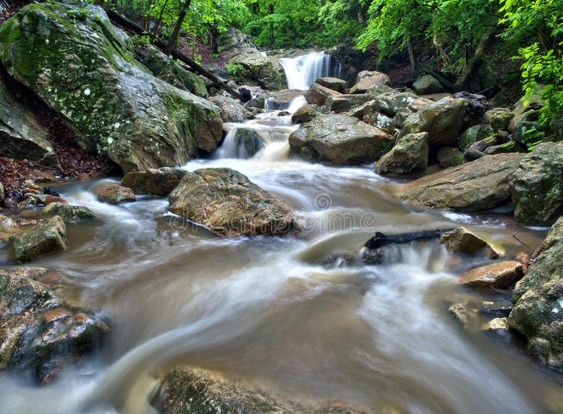 Maryland forest waterfall. Recent heavy rainstorm feeds a Maryland forest waterfall in the Patapsco State Park near Ellicott City, Maryland royalty free stock photography