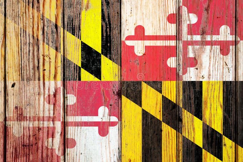 Maryland USA tillståndsnationsflagga på en grå träbrädebakgrund på dagen av självständighet i olika färger av blått rött och royaltyfria foton