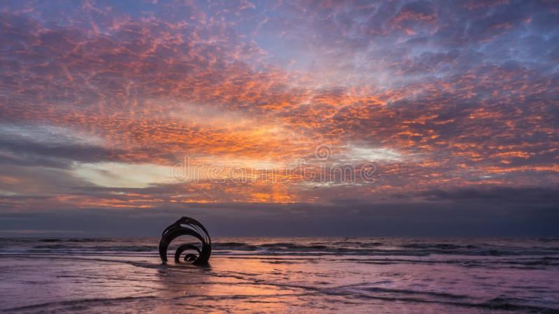 Marys Shell, Cleveleys in Lancashire. Sunset at the beach at Cleveleys on the Lancashire Coast with the artwork Mary`s Shell in the foreground royalty free stock photo