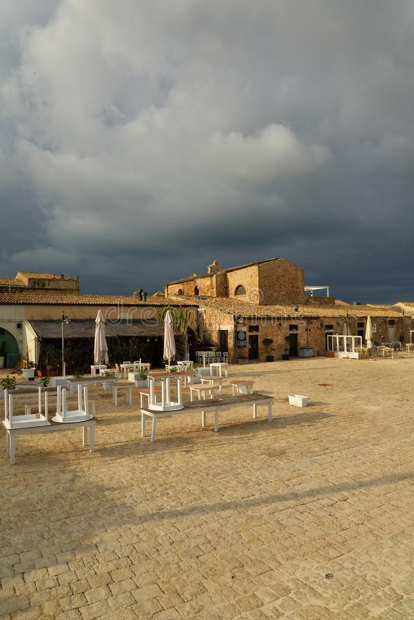 Marzamemi, Sicily, Italy. the old village square. Village of Marzamemi, province of Siracusa, Sicily, Italy. The old town square in winter. Dramatic weather stock photo