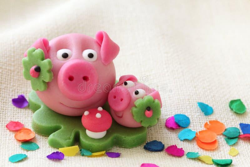 Marzipan pig. With cloverleaf and mushroom stock photo