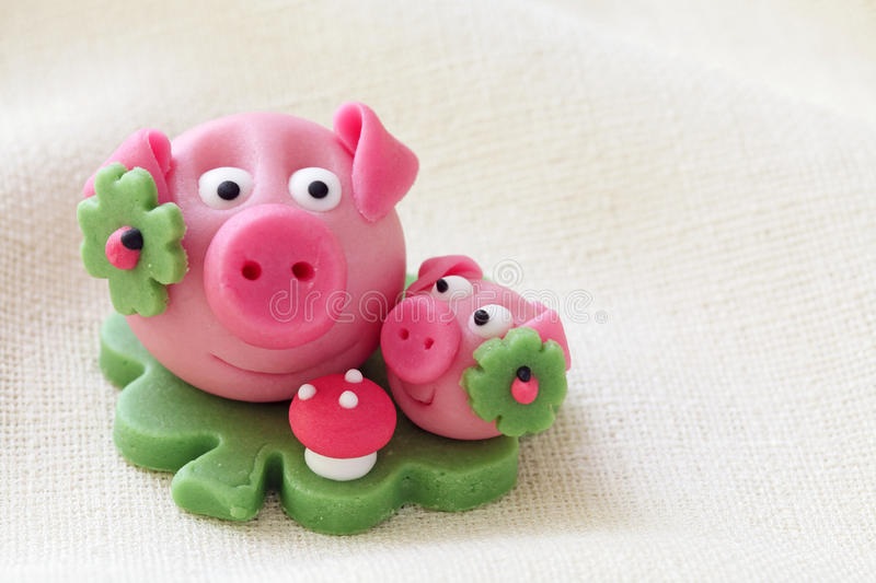 Marzipan pig. With cloverleaf and mushroom royalty free stock photography