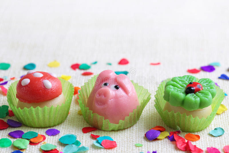 Marzipan pig,mushroom and cloverleaf. On white background stock photo