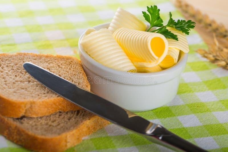 masło chlebowi kędziory zdjęcia stock
