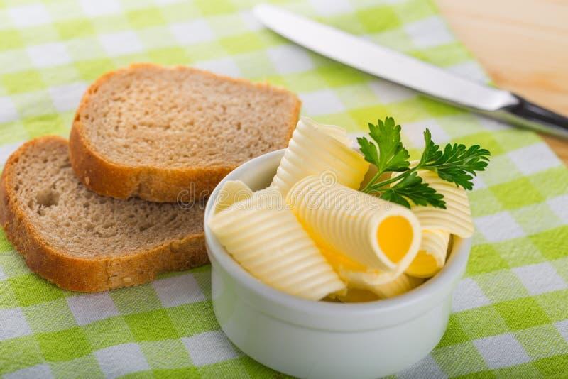 masło chlebowi kędziory obrazy stock