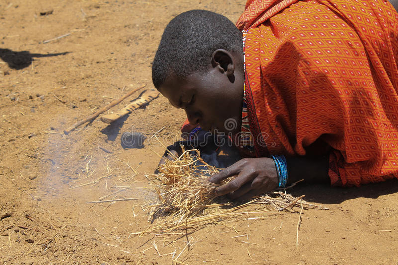 Masai and the fire stock images